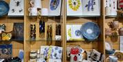 Local artworks, cards, candles, pin cushions, prints, teatowels, mugs and notebooks