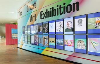 A colourful wall in Firstsite displaying the Great Art Exhibition
