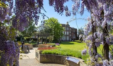 Hollytrees Museum Exterior with Wisteria