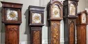 Clocks in the Bernard Mason Clock Gallery in Hollytrees Museum