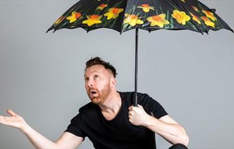 Jason Byrne Under an Umbrella