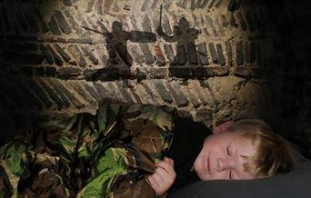 A child asleep in Colchester Castle