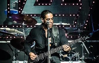 LImehouse Lizzy on stage with guitar