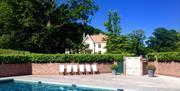 Glistening swimming pool at the Maison Talbooth
