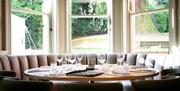An alcove table set for dinner
