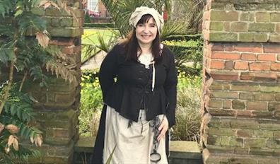 A tour guide dressed as 'Aggie - the jailer's wife'