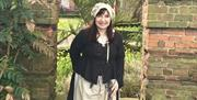 A tour guide in costume as 'the jailer's wife'