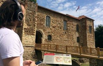 Listening to an audio tour by Colchester Castle