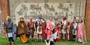 Roman re-enactors in front of a modern day mosaic