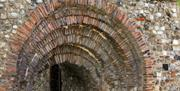 A closeup of an archway in St Botolph's Priory