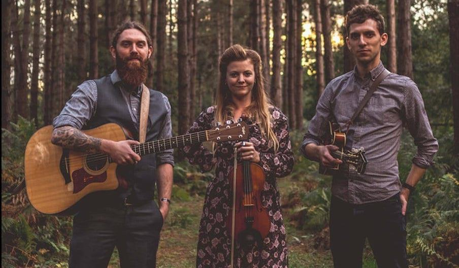 Shakleton Trio in woods with instruments