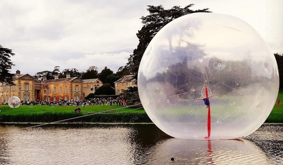 A large inflatable sphere on a lake