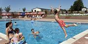 Family fun in an outdoors swimming pool