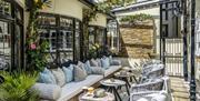 Secret garden terrace with sofa's and lemon trees