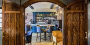 Looking through wooden doors to bar area