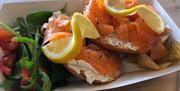 Smoked Salmon Bagel with Lemon Slice and Salad