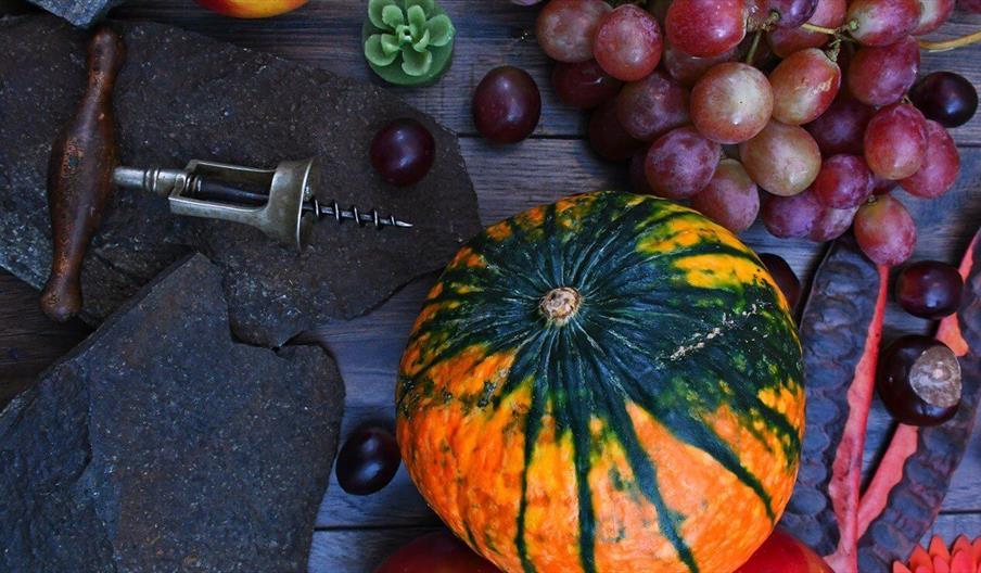 Pumpkin, grapes, and corkscrew