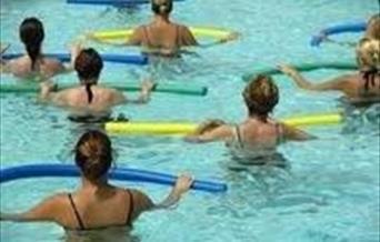 Water aerobics class in the swimming pool