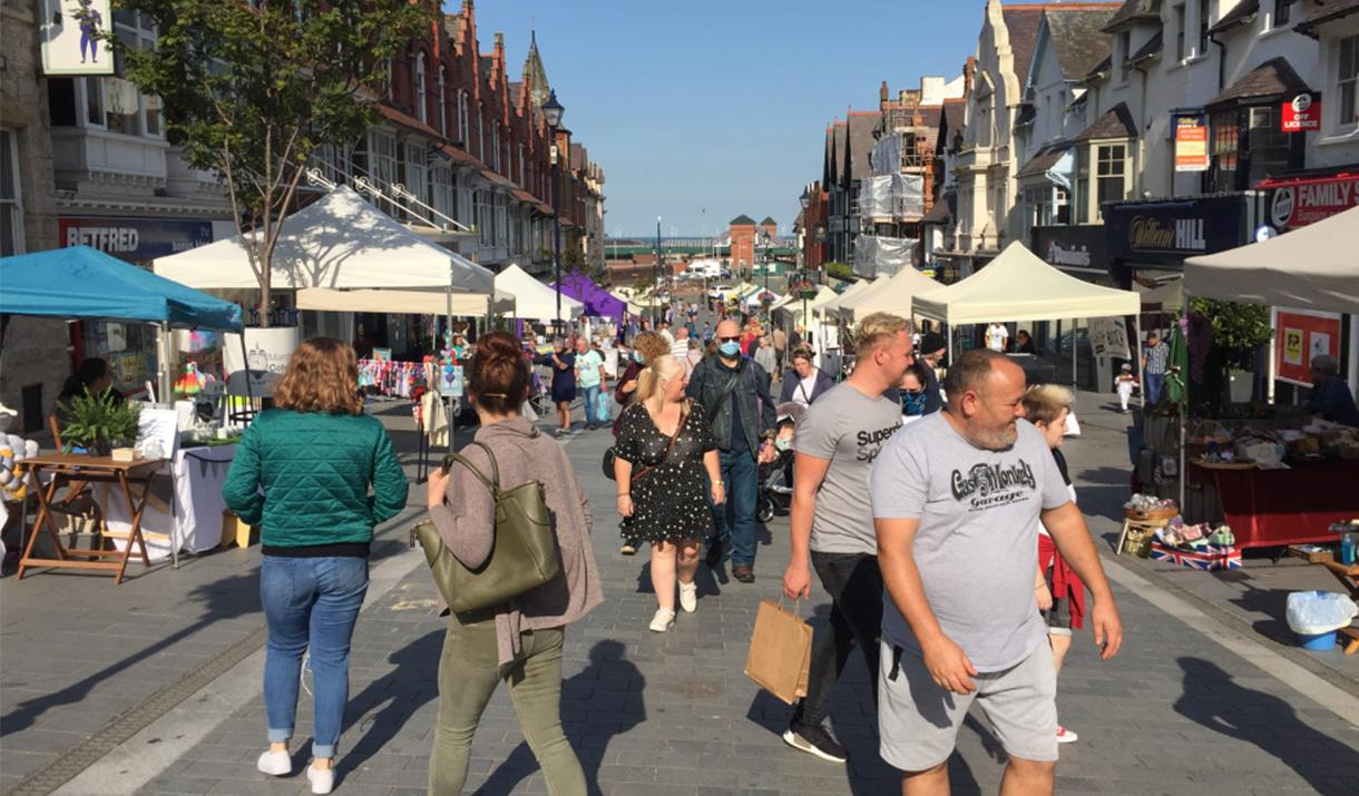 Image shows people at the Colwyn Bay Artisan Market