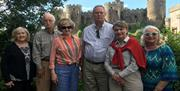 Group of adults standing in front of Conwy castle