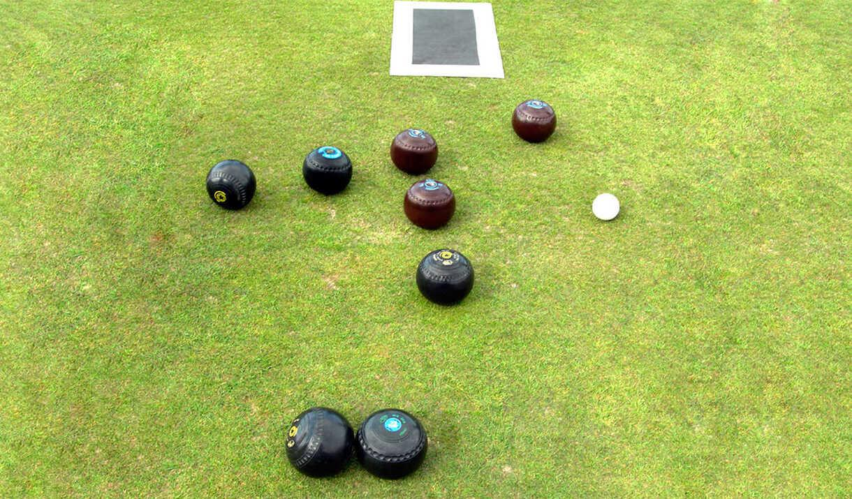 Image of bowls on a bowling green