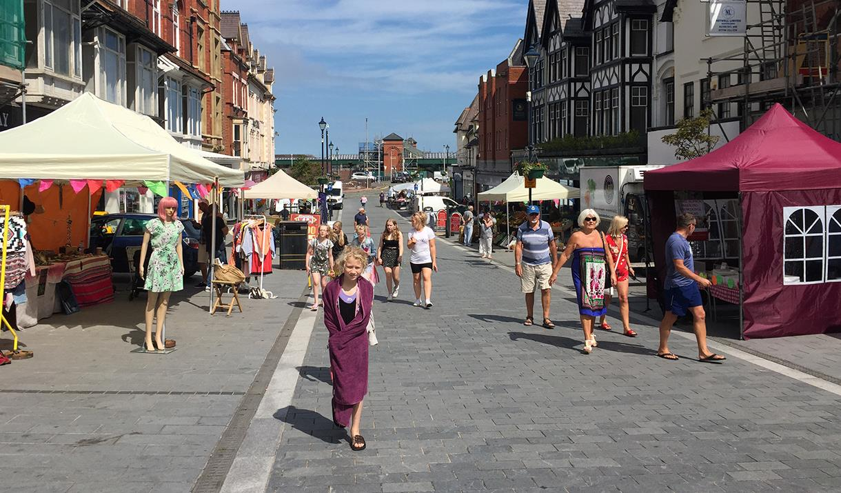 Image shows people at Colwyn Bay Local Market
