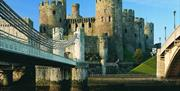 Conwy Castle with Telford's Suspension Bridge to the left of the image.