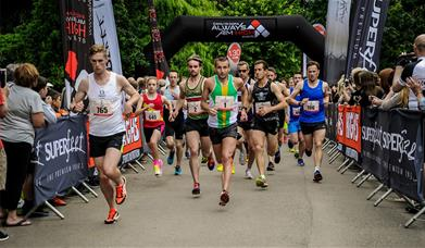 Image shows runners setting off at start of a race