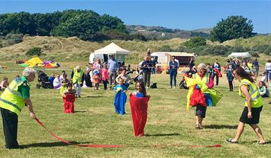 Image shows children in a sack race at Deganwy Prom Day
