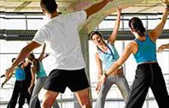 People exercising in a fitness class