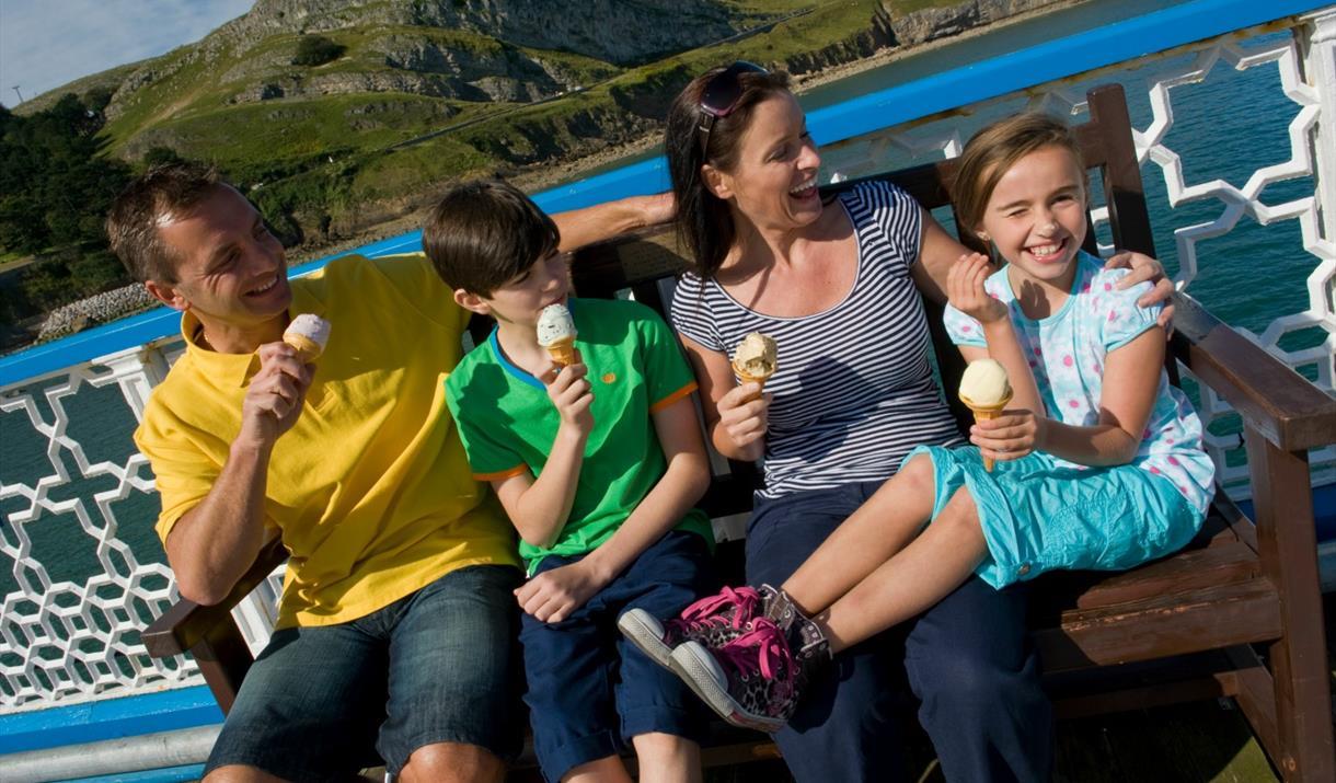 Family enjoying ice cream on Llandudno Pier