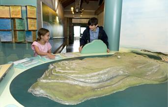 Two children looking at the Great Orme model, Great Orme Country Park, Llandudno.