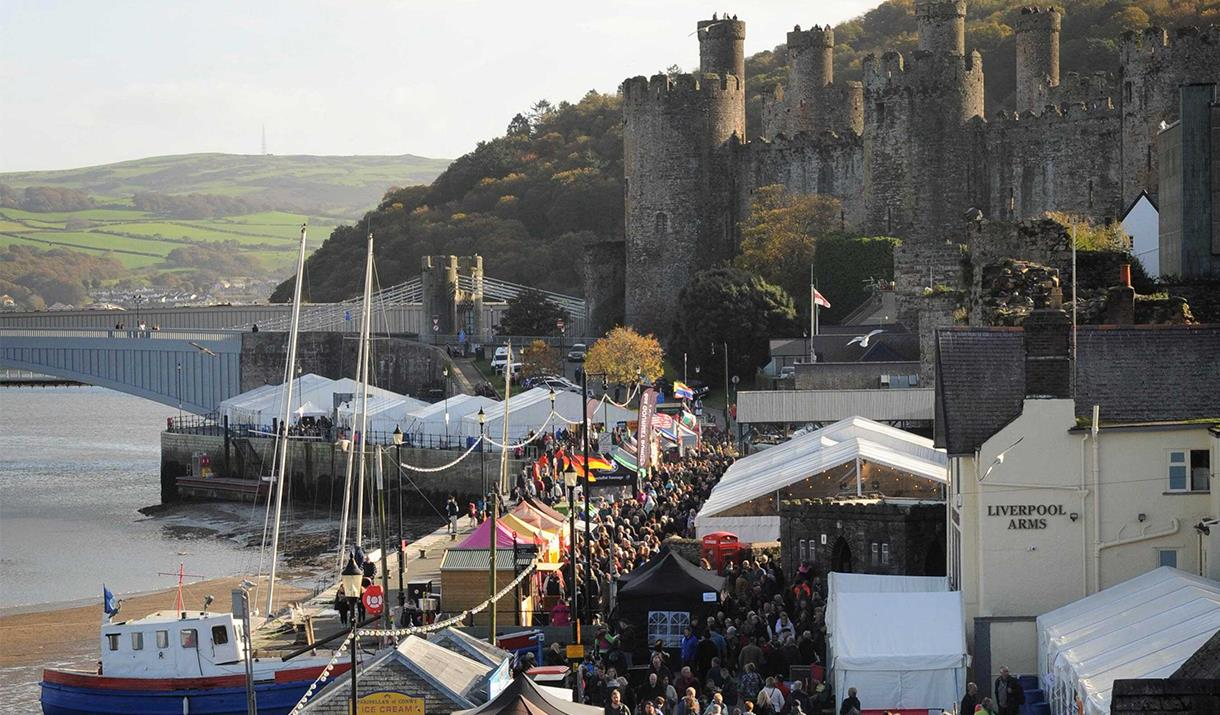 Image shows Gwledd Conwy Feast stalls on the Quay in front of Conwy Castle