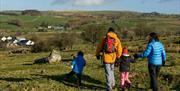 Family walking in the Hiraethog moors