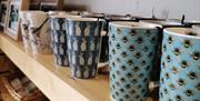 A choice of mugs on sale inside the Conwy TIC.