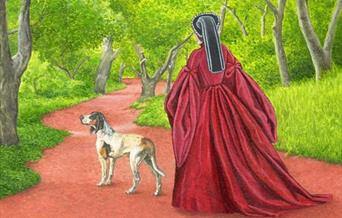 Picture of Lady in Tudor dress walking through forest with a dog