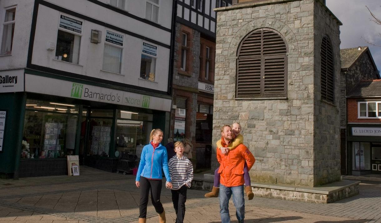 A family walking in Ancaster Square, Llanrwst