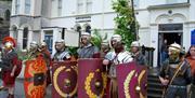 Men dressed as Roman soldiers outside Llandudno Museum