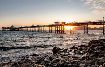 An image of Llandudno pier at sunset