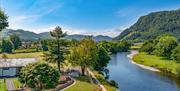 Image of birds eye view of stunning river and  forest landscape Rwst Holiday Lodges