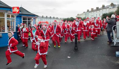 Image shows competitors in the Llandudno 5K Santa Dash