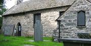 Entrance to St Michael's Old Church and some gravestones