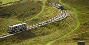 Two trams travelling on the Orme.