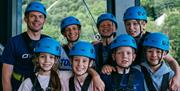 Family group wearing climbing equipment