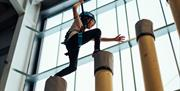 Child jumping posts at Adrenaline Indoors