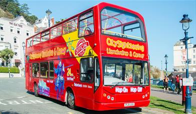 Red City Sightseeing Bus picking up passengers at Llandudno Pier