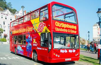 Red City Sightseeing Bus picking up passengers at Llandudno Pier