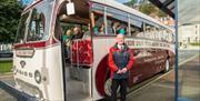 Bus driver stood outside the Marine Drive tour bus