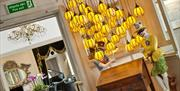 Hanging lights in the reception area, Empire Hotel