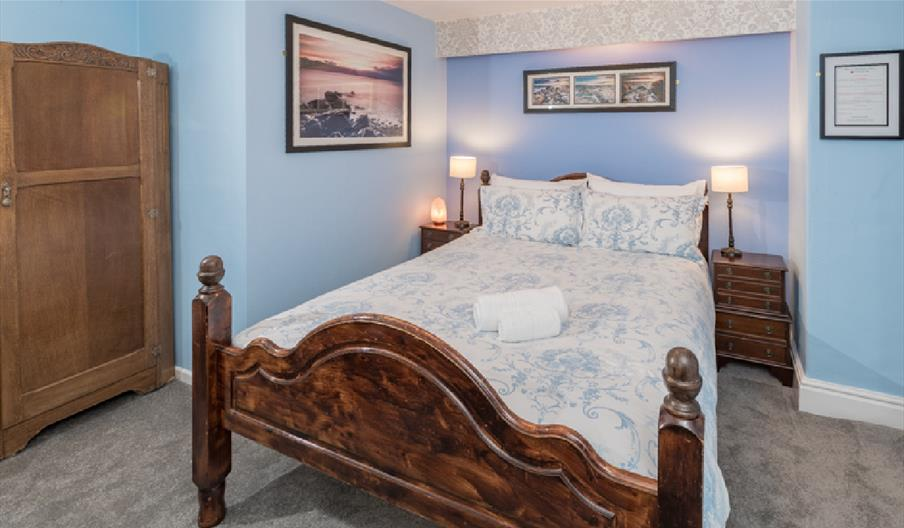 Double bedroom decorated with a blue theme at Bryn Woodlands Guest House
